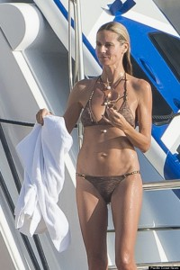 Heidi Klum jet skis with a friend during her vacation in St Barts