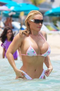 "Nicole ""Coco"" Austin, rapper Ice T's model-wife, flaunts her curvy figure in a thong rose printed bikini while vacationing in Miami Beach with a friend"