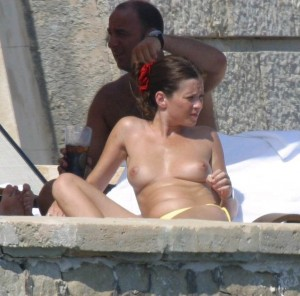 Anna Friel topless on beach catched
