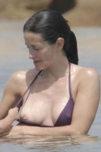 Courteney Cox nipple slip beach