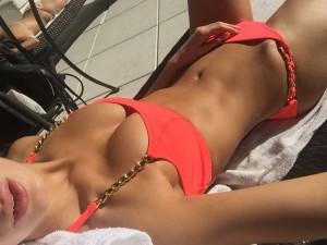 Tika Camaj bikini cleavage