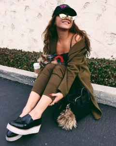 Stella Hudgens walking with dog