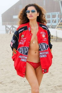 Blanca Blanco brings color and sex appeal to the beach on a gloomy day!
