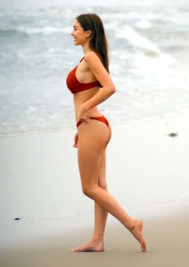 Bikini model Sophie Mudd shows off her curvy assets as she runs on the beach in Malibu as she smiles while nearly falling out of her top in LA
