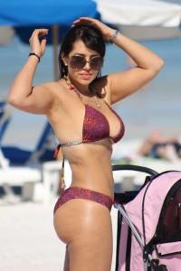 Andrea Calle hits the beach in Miami, FL