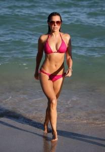 Model Sylvie Meis wears a hot pink string bikini as she hits the beach in Miami